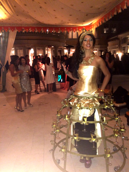 arabian nights themed birthday party with a golden champagne skirt hostess by www.catalystarts.com