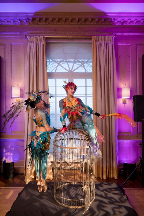 Catalyst Arts body painted birds of paradise ballerinas with giant golden cage in penthouse for private birthday event
