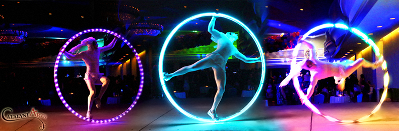 LED Cyr Wheel Circus Stage Performer- bookable by www.catalystarts.com in California