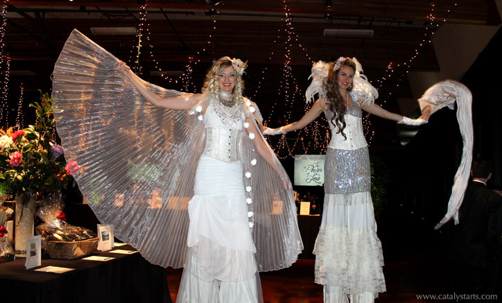 white sparkly stilt walkers at wedding - www.catalystarts.com