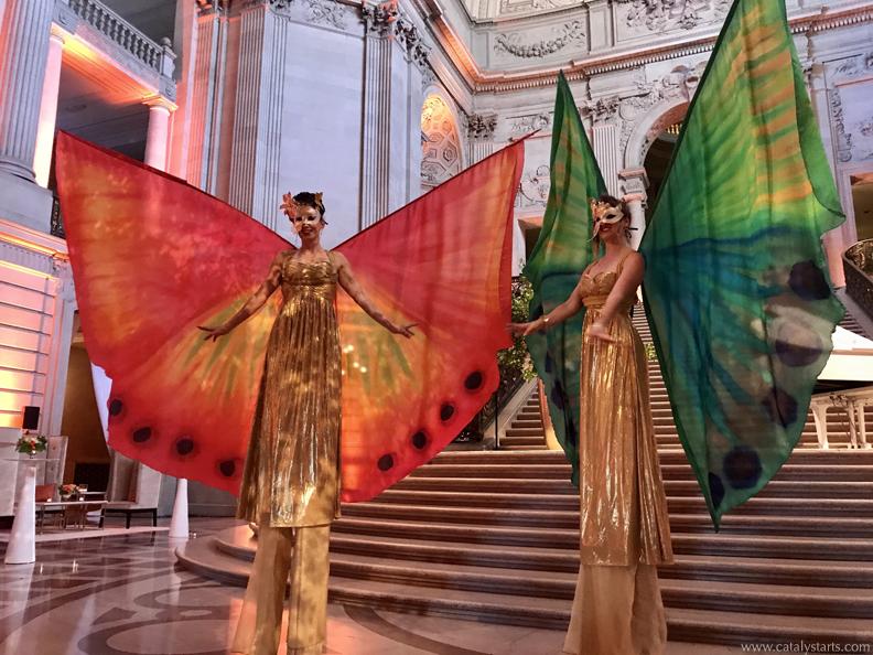 Winged Masquerade Stilt Walkers + butterfly stilt walkers by Catalyst Arts California