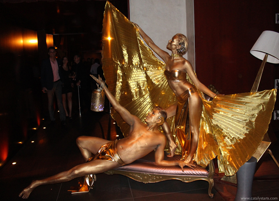 Gold Party in SF- Golden statue body painted dancers & face paint zone by www.catalystarts.com for Donovan & Gold Rush Rally- body painter Audette Sophia