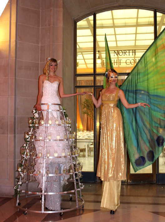Deluxe Drinks Stilt Champagne Skirt & Masquerade Stilt Butterfly by Catalyst Arts
