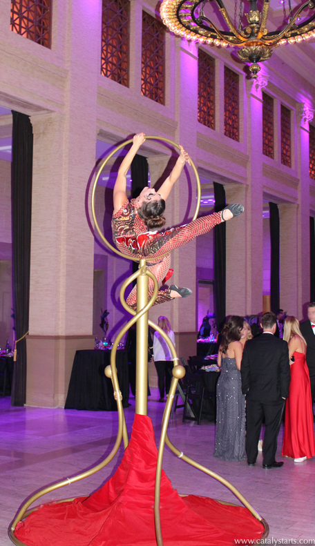 Aerialist on Golden Lolipop freestanding Lyra - Catalyst Arts Entertainment