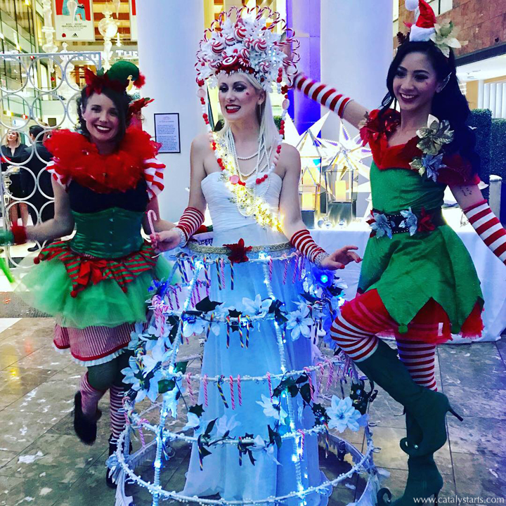 Christmas Elves & Candycane Champagne Skirt by Catalyst Arts Entertainment in San Francisco, CA at Holiday Party