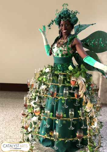 Green Hostess- Secret Garden themed Champagne Skirt for Gala in California - concept/booking- Catalyst Arts